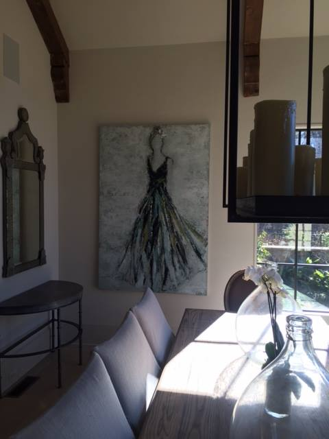 Beautiful room decor with a large painting by Holly Irwin